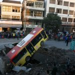 "A bus ""sank"" in a crater in the middle of a road"