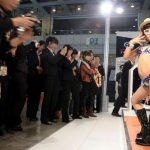Scandal at Chinese Motorshow: baby models in bikini