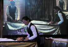 Chinese Mortuary providing massages to the deads