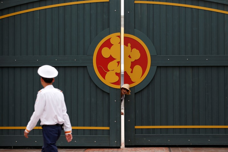 A woman stands outside a gate in Shanghai Disney Resort during a three-day Grand Opening events in Shanghai, China, June 15, 2016. REUTERS/Aly Song