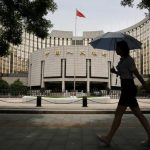 China's state planner drops call for monetary easing from statement