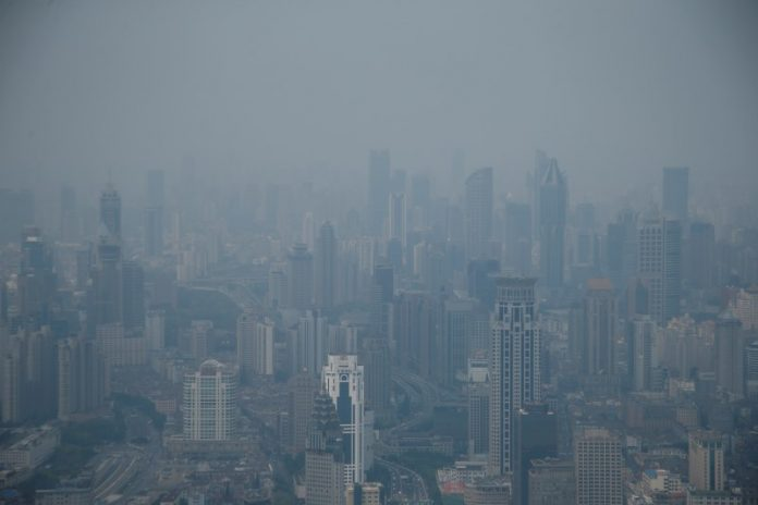 A general view of buildings in Puxi district from the Jin Mao Tower amid heavy smog in Shanghai