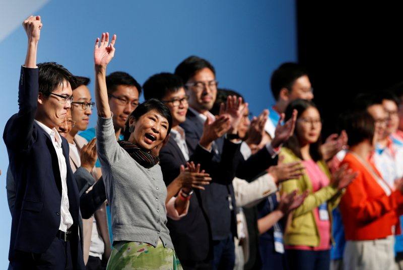 Claudia Mo (2nd L), from Civic party, celebrates after winning a seat in the Legislative Council election, in Hong Kong, China September 5, 2016. REUTERS/Tyrone Siu