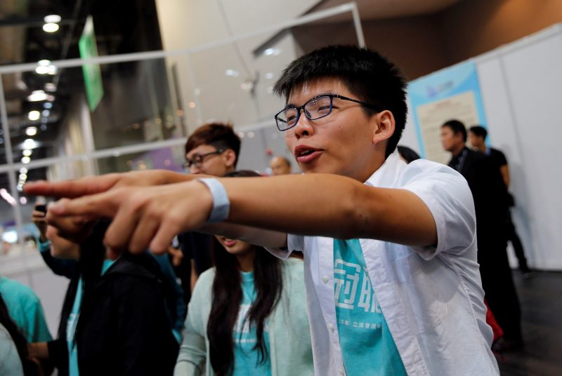 Student leader Joshua Wong celebrates after candidate Nathan Law won a seat in the Legislative Council election in Hong Kong, China September 5, 2016. REUTERS/Tyrone Siu