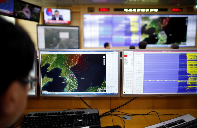 An employee looks at where seismic waves observed in South Korea came from, during a media briefing at Korea Meteorological Administration in Seoul, South Korea, September 9, 2016. REUTERS/Kim Hong-Ji