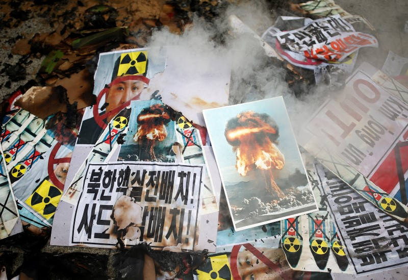 Smoke rises from burnt banners during an anti-North Korea rally in central Seoul, South Korea, September 10, 2016. REUTERS/Kim Hong-Ji