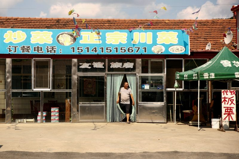 A man steps out of a restaurant in Gulou Village outside China's Dandong, Liaoning province, at the border with North Korea, September 11, 2016. REUTERS/Thomas Peter