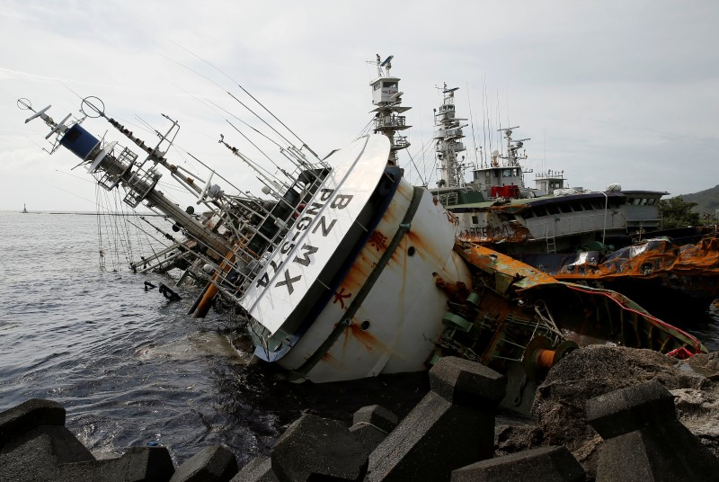 A partially capsized fishing ship is seen after Typhoon Meranti made landfall, in Kaohsiung