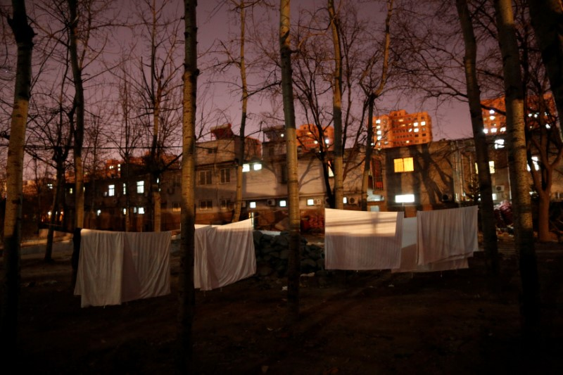 Laundry hangs on a clothes line in front of the accommodation where some patients and their family members stay while seeking medical treatment in Beijing, China, January 11, 2016. REUTERS/Kim Kyung-Hoon