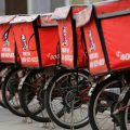 File photo of logos of KFC, owned by Yum Brands Inc, are seen on its delivery bicycles in front of its restaurant in Beijing