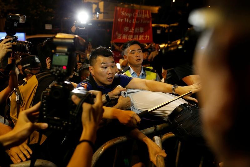 A demonstrator is detained by police during a protest against what they call Beijing's interference over local politics and the rule of law in Hong Kong, China November 6, 2016. REUTERS/Tyrone Siu
