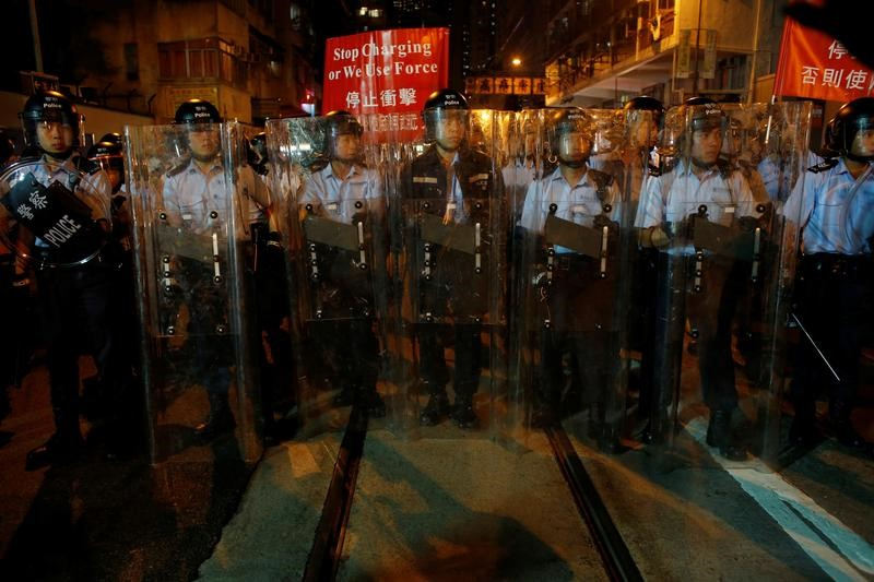 Riot police stand on a tram track during a standoff with protesters outside China Liaison Office in Hong Kong, China November 6, 2016.      REUTERS/Bobby Yip
