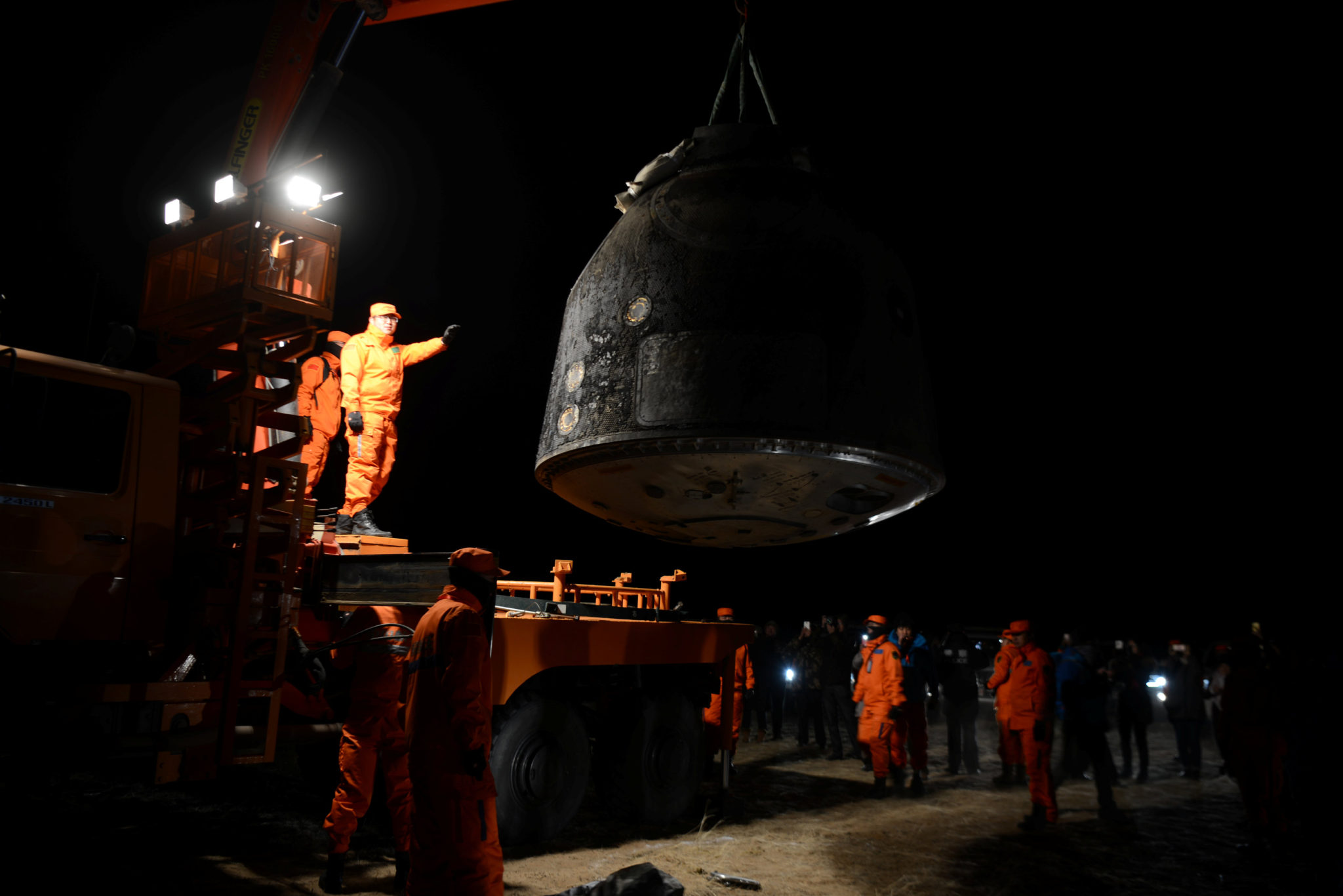 The re-entry capsule of China's Shenzhou-11 spacecraft is loaded on a truck, north of Inner Mongolia Autonomous Region, China, November 18, 2016. China Daily/via REUTERS