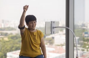 A staff member demonstrates the use of the tele-rehabilitation system at the National University Health System in Singapore June 30, 2016. Tele-rehabilitation allows therapists to remotely monitor the rehabilitation of stroke patients.\n\nMinistry of Communications & Information via Reuters