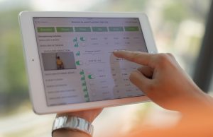 A staff member demonstrates the use of the tele-rehabilitation app on the tablet at the National University Health System in Singapore June 30, 2016. Tele-rehabilitation allows therapists to remotely monitor the rehabilitation of stroke patients.\n\nMinistry of Communications & Information via Reuters