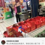 Boy peeing in a sink of a Chinese shopping center