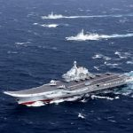 China says aircraft carrier testing weapons in South China drills