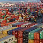 Container boxes are seen at the Yangshan Deep Water Port, part of the Shanghai Free Trade Zone, in Shanghai