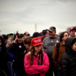 The crowd on the National Mall reacts during the inauguration of U.S. President Donald Trump in Washington