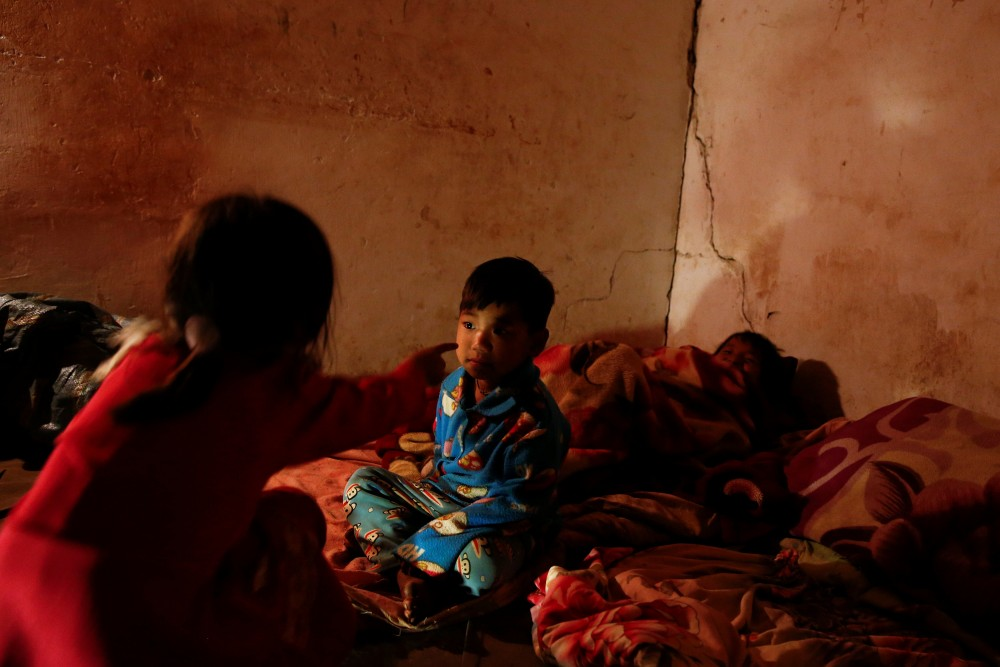 Refugee children who fled with their family fighting in neighbouring Myanmar