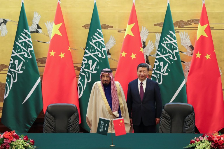 Chinese President Xi Jinping and Saudi Arabia's King Salman bin Abdulaziz Al-Saud attend a signing ceremony at the Great Hall of the People in Beijing