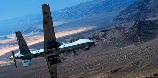 An MQ-9 Reaper remotely piloted drone aircraft performs aerial maneuvers over Creech Air Force Base