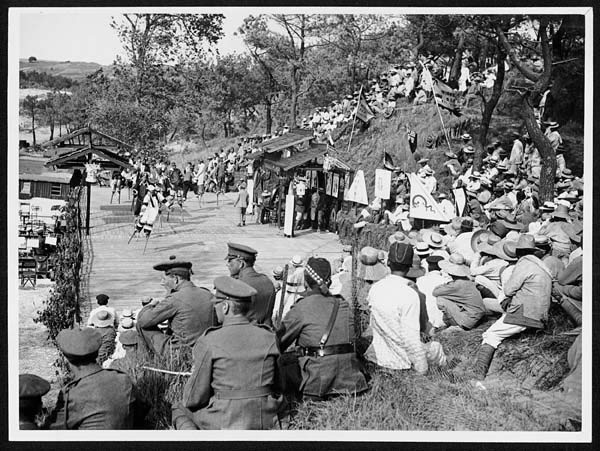 Chinese entertain soldiers and nurses in an open air theatre in France