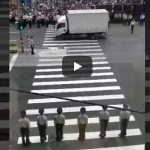 Chinese police agents organizing the crossing of pedestrians in China