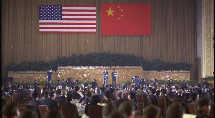 Richard Nixon and Zhou Enlai speaking at a banquet