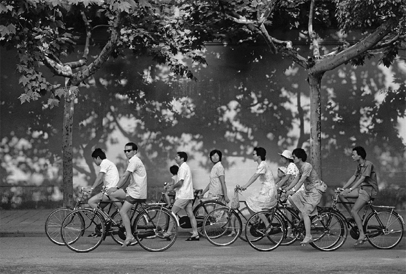 Robin Moyer, Bicycles and Poster Extoling the Virtues of the One Child Policy in Suzhou, Jiangsu, 1988